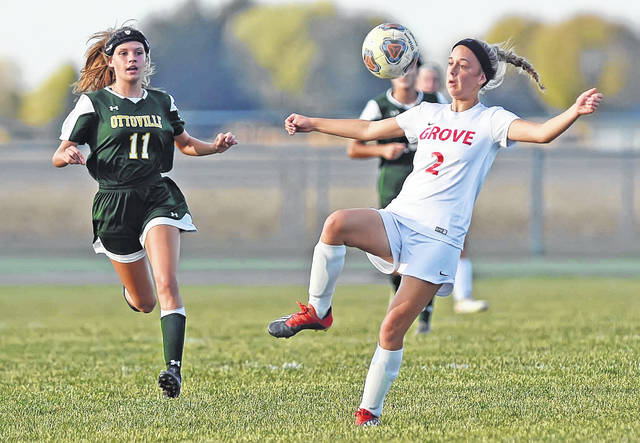 Columbus Grove's Landyn Dotson (2) tries to keep control of the ball against Ottoville's Eryn Kemper during Thursday's Division III sectional final at Ottoville. See more match photos on 3C.