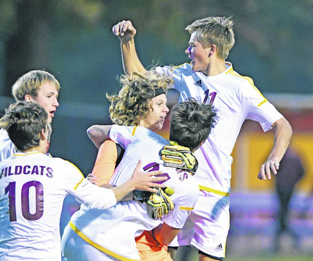 Kalida teammates celebrate after a victory against Ottoville during Wednesday's Division III district semifinal match at Kalida High School. The Wildcats won 1-0. Richard Parrish | The Lima News