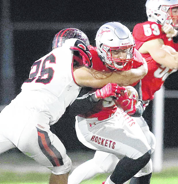 Pandora-Gilboa's Ethan Luginbill fights for yards against Mohawk's Jesse Leeth during Friday night's Division VIII playoff game at Pandora-Gilboa.