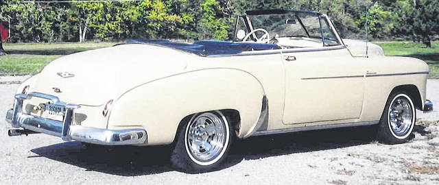 Jim Bechtel's 1949 Chevy Deluxe Convertible was a cream color when he had it in October 2007. The previous owner had it since 1973.