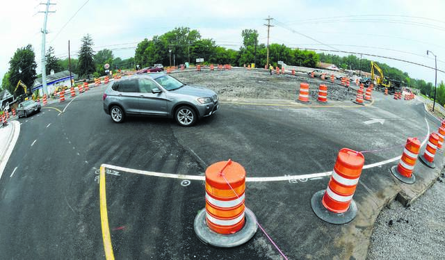 FILE — Traffic flows around the roundabout on Shawnee and Fort Amanda roads in Shawnee Township when it was first opened in 2015.
