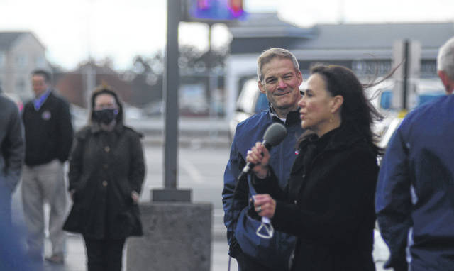 Rep. Jim Jordan and Ohio Republican Party Chair Jane Timken rally the crowd at a small event outside of the Trump Victory Center on Friday.
