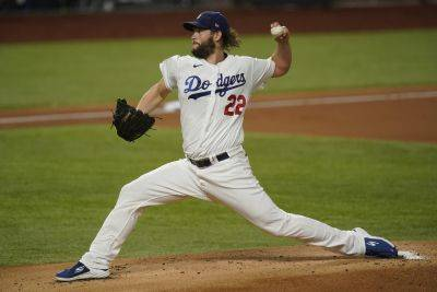 Los Angeles Dodgers starting pitcher Clayton Kershaw allowed one run and two hits, struck out eight and walked one in a six-inning outing Tuesday night to open the World Series against Tampa Bay at Globe Life Field in Arlington, Texas. (AP photo)