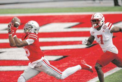 Ohio State's Garrett Wilson makes a touchdown reception against Nebraska's Dicaprio Bootle during Saturday's game in Columbus.