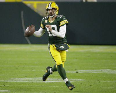 Quarterback Aaron Rodgers (12) has the Green Bay Packers off to a 4-0 start. (AP photo)