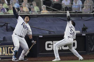 Tampa Bay Rays Randy Arozarena (56) celebrates his two run home run against the Houston Astros with Ji-Man Choi during Game 7 of the American League Championship Series on Saturday in San Diego. (AP photo)