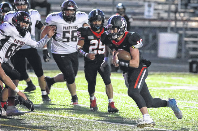 Spencerville's Dalty Prichard looks for room to run during Friday night's Division VII home playoff game against McComb.
