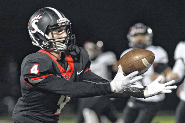 Spencerville's Cody Bockey makes a catch during Friday night's Division VII home playoff game against McComb. See more game photos at LimaScores.com.