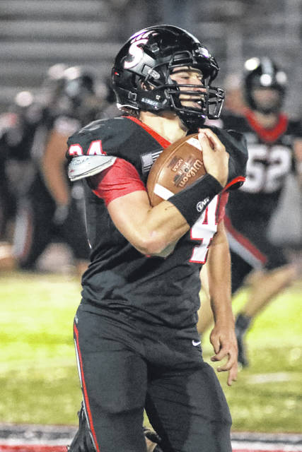 Spencerville's Gunner Grisby carries the ball during Friday night's Division VII playoff home game against McComb.