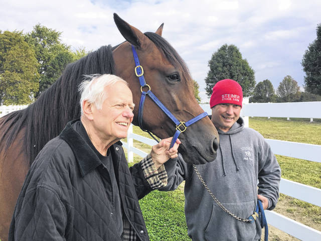 David Steiner, the owner of Steiner Stock Farm, and farm manager Al Menke revisit their Little Brown Jug victory on Sept. 24 by Captain Barbossa, a 3-year-old gelding born and raised on the farm.