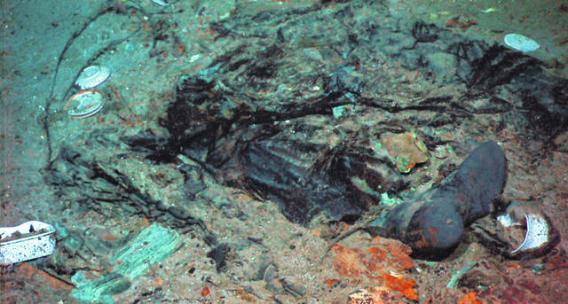 This 2004 photo shows the remains of a coat and boots in the mud on the sea bed near Titanic's stern.