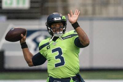 A Seattle victory Sunday in a game switched to prime time would be Russell Wilson's 92nd regular-season win, tying Peyton Manning for the most in a quarterback's first nine seasons. (AP photo)