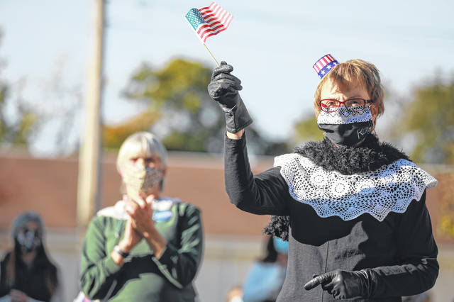 Barb Stetttler of Bluffton dresses as Ruth Bader Ginsburg during the Women's Ride to Vote event held on Saturday morning.