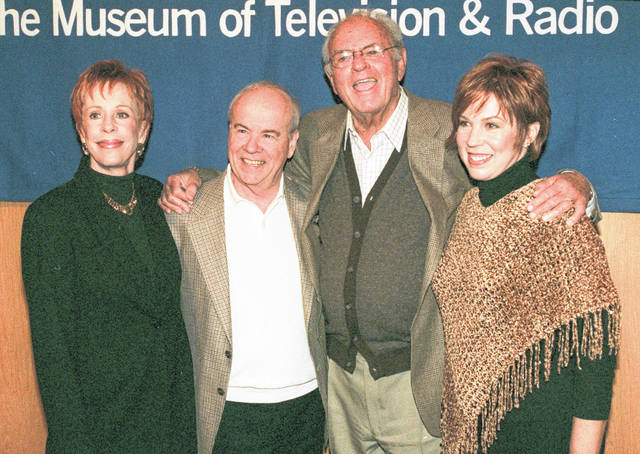 """Cast members of """"The Carol Burnett Show,"""" from left, Carol Burnett, Tim Conway, Harvey Korman and Vicki Lawrence, pose for a photo before attending a discussion of the former television show at the Director's Guild Theater in the Hollywood section of Los Angeles, on March 3, 2000. Episodes of """"The Carol Burnett Show"""" are available on streaming services like Tubi and The Roku Channel."""