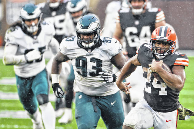 Cleveland Browns running back Nick Chubb (24) rushes during the second half of an NFL football game against the Philadelphia Eagles, Sunday, Nov. 22, 2020, in Cleveland. (AP Photo/Ron Schwane)