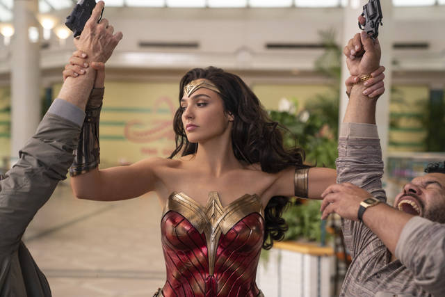 "Gal Gadot appears in a scene from ""Wonder Woman 1984."" WarnerMedia last week announced that ""Wonder Woman 1984"" — a movie that might have made $1 billion at the box office in a normal summer — will land in theaters and on HBO Max nearly simultaneously next month."