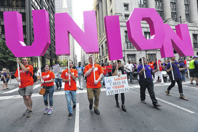 Union supporters participate in a 2017 Labor Day march in downtown Chicago.