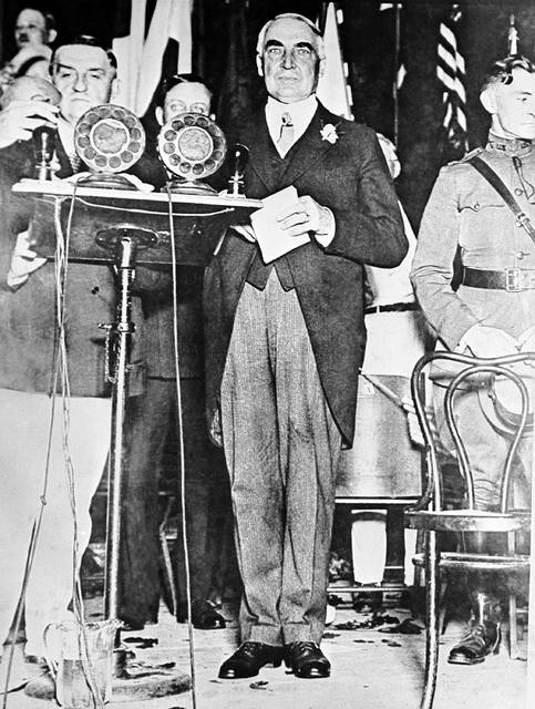 FILE-This 1918 file photo shows President Warren G. Harding delivering an address in St. Louis, Mo. The centennial of President Warren G. Harding's election was marked Monday in his home county in Ohio with a modest radio tribute rather than the grand museum and homestead re-opening envisioned before the pandemic. Harding, a Republican, was elected Nov. 2, 1920, his 55th birthday, succeeding Democrat Woodrow Wilson. He beat a fellow Ohio newspaper publisher, James Cox, on a platform of restoring normalcy after World War I and the 1918 influenza pandemic.