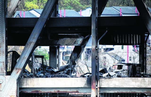 FILE — Covington Police and Covington Fire departments work an accident and fire scene on the Brent Spence Bridge Wednesday, Nov. 11, 2020, in Covington, Ky.