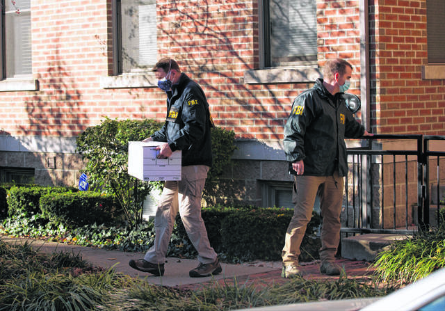 FBI agents remove items from the German Village home of Public Utilities Commission of Ohio Chairman Sam Randazzo in Columbus, Ohio on Monday, Nov. 16, 2020.