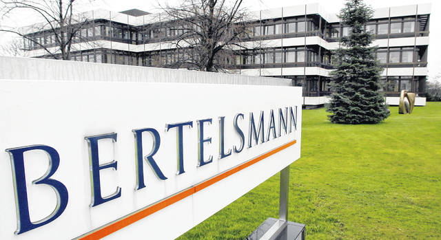 FILE — This March 13, 2003 file photo shows an exterior view of the German media giant Bertelsmann in Guetersloh, Germany. German media giant Bertelsmann said Wednesday that it is buying publisher Simon & Schuster from ViacomCBS for $2.17 billion in cash.