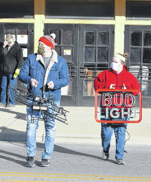 Neon beer signs were a big seller at the Avante Garage sale Saturday at The Ohio Theatre, 122 W. North St., Lima.