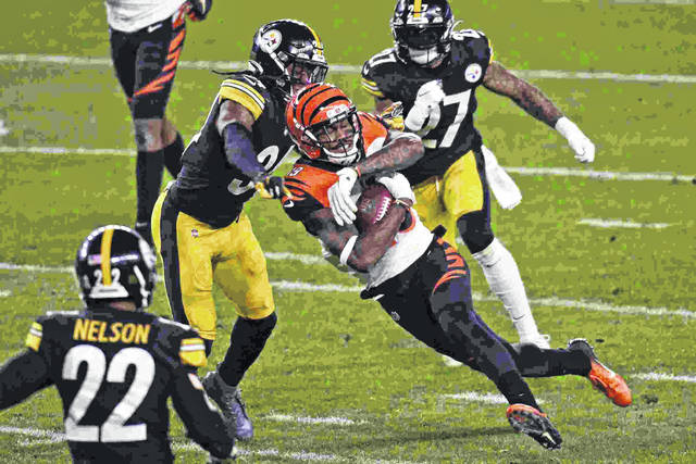 Cincinnati Bengals wide receiver Auden Tate (19) is tackled by Pittsburgh Steelers strong safety Terrell Edmunds (34) during the Steelers' 36-10 win over the Bengals in Pittsburgh on Sunday.
