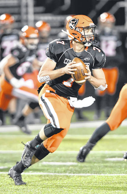 Coldwater's Myles Blasingame looks to pass during Saturday night's Division VI state semifinal against Columbus Grove at Sidney.