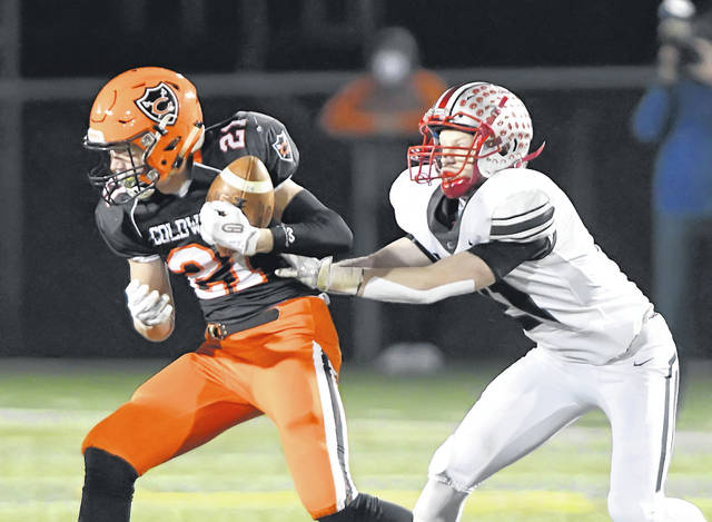Coldwater's Tyler Schwieterman catches a pass against Columbus Grove's Gabe Clement during Saturday night's Division VI state semifinal at Sidney. See more game photos on 3C and LimaScores.com.