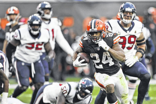 Cleveland Browns running back Nick Chubb (24) rushes for a 9-yard touchdown during the second half of the Browns' 10-7 win over the Houston Texans on Sunday.