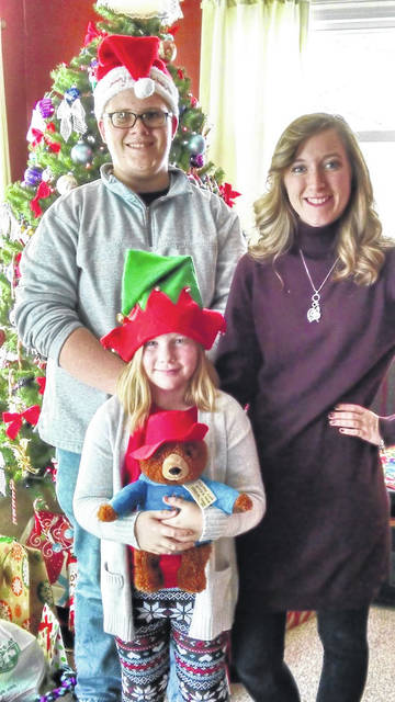 Colby Hildreth appears with his sisters Jillian and Raygen at Christmas.