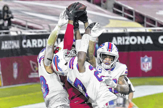 Arizona Cardinals wide receiver DeAndre Hopkins catches the game-winning touchdown as Buffalo Bills cornerback Tre'Davious White, center, free safety Jordan Poyer, right, and strong safety Micah Hyde, left, defend during the second half of an NFL football game, Sunday, Nov. 15, 2020, in Glendale, Ariz.