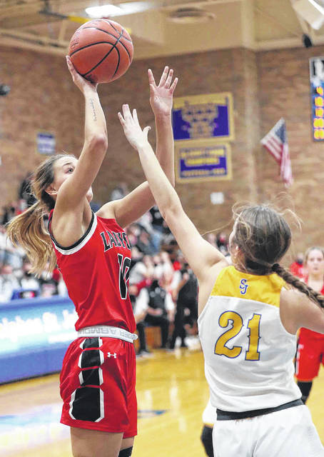 Delphos Jefferson's Kaylee Buzard puts up a shot against Abby Buettner of Delphos St. John's during Friday night's game at Delphos St. John's