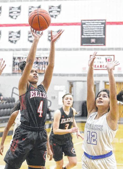 Elida's Amira Freeman, here putting up a shot against Defiance's Tammy Aguilera, was an All-WBL first team selections as a junior.