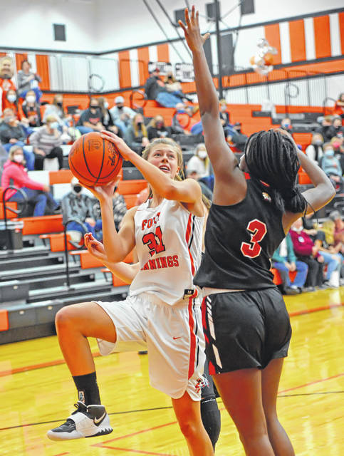 Fort Jennings' Reilly Fitzpatrick attempts a shot against Shawnee's Zoe Best during Saturday night's game at Fort Jennings. See more game photos at LimaScores.com.