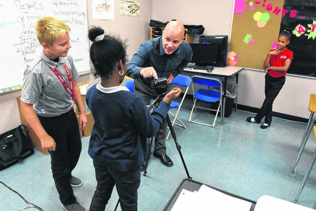 FILE — Last fall, Nick Kellis teaches multimedia to fourth graders at Heir Force Community School in Lima.