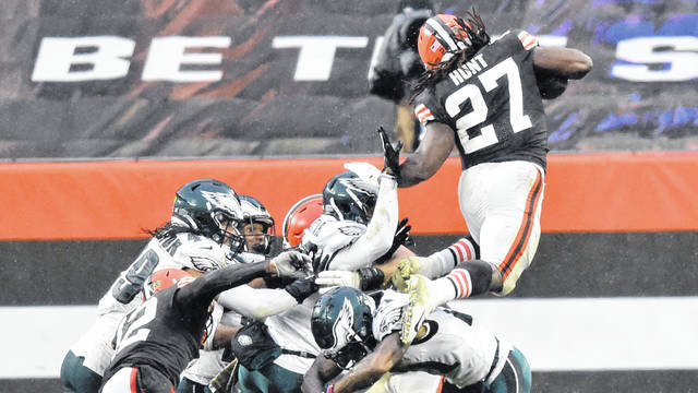 Cleveland Browns running back Kareem Hunt (27) launches himself into the end zone from the 5-yard line for a touchdown during the Browns' 22-17 win over the Philadelphia Eagles on Sunday.