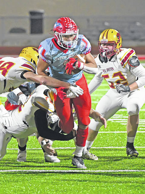 Lima Central Catholic's Rossy Moore battles for yardage during Friday night's Division VII state semifinal against New Bremen in Wapakoneta.