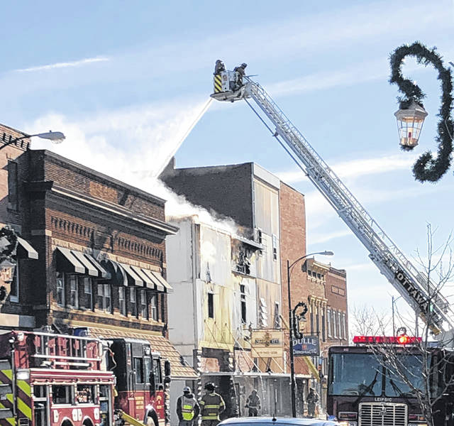 Fire crews from Putnam, Henry and Allen Counties help fight a blaze at Smokin' B's Bar & Grill in Leipsic on Sunday morning.
