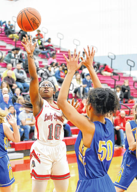 Lima Senior's Nakiya Sigman, here putting up a shot against Findlay's Bri Nichols, was named first All-Three Rivers Athletic Conference as a junior.
