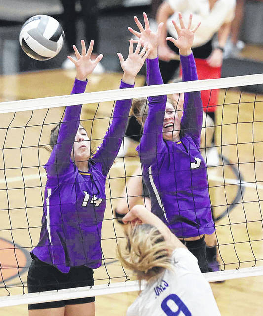 Leipsic's Ava Henry, left, Elizabeth Scheckelhoff defend a shot by Tiffin Calvert's Ashlyn Jones during Saturday Division IV regional final at Elida. See more match photos at LimaScores.com. Don Speck | The Lima News