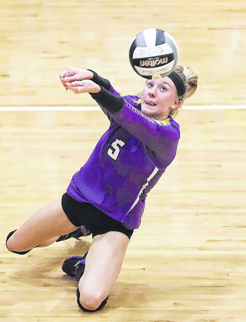 Leispic's Peyton Heitmeyer keeps the ball alive during Saturday's Division IV regional final against Tiffin Calvert at Elida.