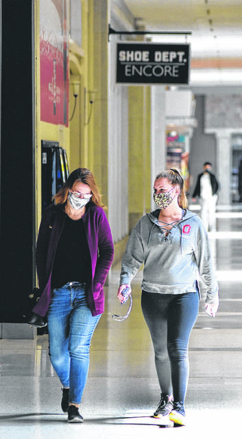 FILE — Loretta Burgei, left, and her daughter, Alicia, shop at the Lima Mall in May. The Burgeis are from Ottoville.