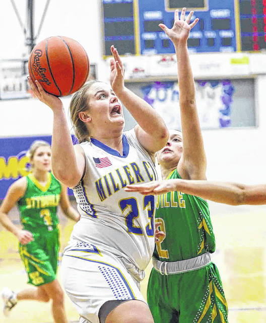 Miller City's Natalie Koenig (23), here driving against Ottoville's Jocelyn Geise, received All-Putnam County League first team recognition as a sophomore and junior.