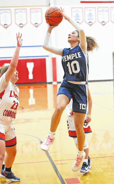 Temple Christian's CeCe Worsham attempts a shot against Perry's Lexenna Lee during Tuesday night's game at Perry.