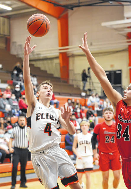 Elida's Austin Miller puts up a shot against Shawnee's Tyson Elwer during Friday night's Mercy Health Tip Off at the Elida Fieldhouse.