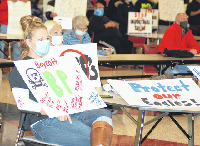Dozens of people protested the Birch Solar Farm project at a public hearing Wednesday night at Apollo Career Center.