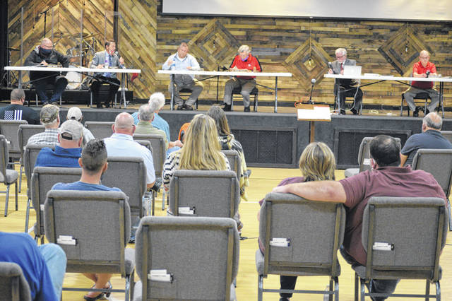 The Shawnee Township Trustees meeting Monday had to be moved from the Shawnee Township House to Shawnee Alliance Church after residents expressed a desire to speak out about the project.