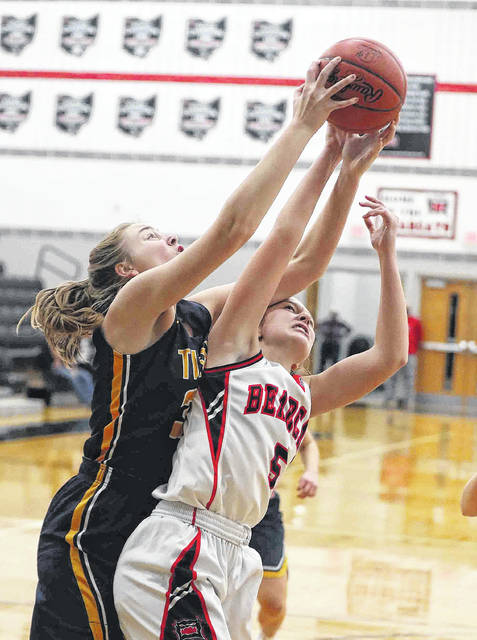 Ottawa-Glandorf's Kaydree Frey, left, and Spencerville's Gabi Croft battle for a rebound during Saturday night's game at Spencerville. See more game photos at LimaScores.com.