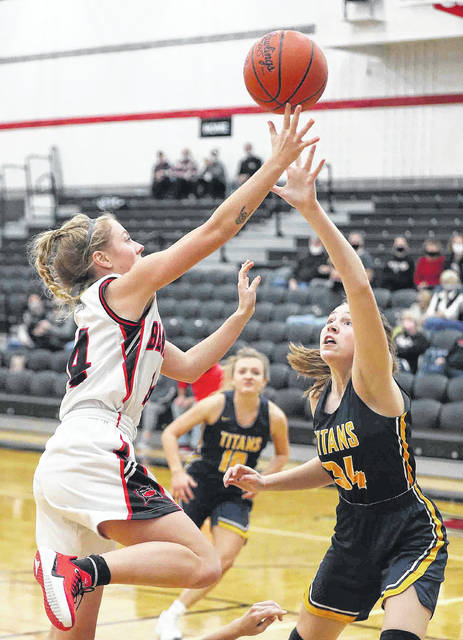 Spencerville's Raigan Staup puts up a shot against Ottawa-Glandorf's Kaydree Frey (34) during Saturday night's game at Spencerville.